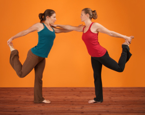 Two Women Perform Yoga